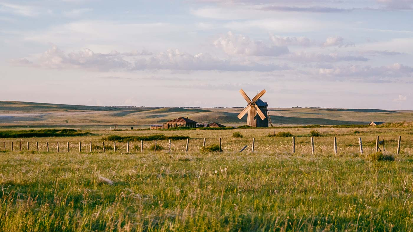 Windmill in isolated field Adobe Stock